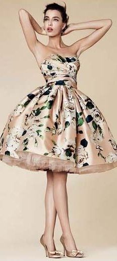 Dolce and Gabanna silk dress with full skirt. Bronze with white flowers and green leaves. So pretty!