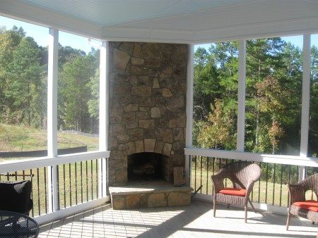 Screen porch with wood burning stone fireplace deck the for Wood burning stove for screened porch