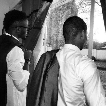 Gentlemen Starring out the window in hope of change