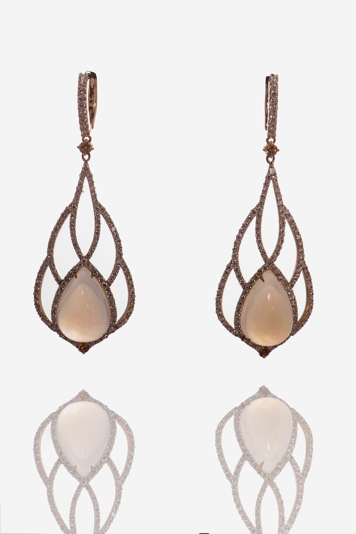 Earrings in rose gold 18Kt with natural opals surrounded by natural white diamonds and fancy orange sapphires