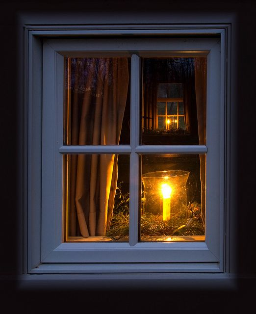 Candle lit windows.... looking in one window and seeing through the room to another... nice! Can 'prim up' the candles for the season! :)