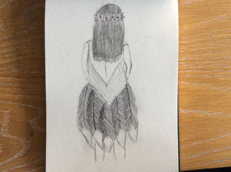 A picture of a girl in a feather dress with a flower headband by moose