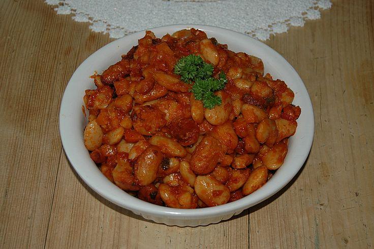 Griechische dicke weiße Bohnen in Tomatensoße, ein schmackhaftes Rezept aus der Kategorie Schmoren. Bewertungen: 11. Durchschnitt: Ø 4,3.