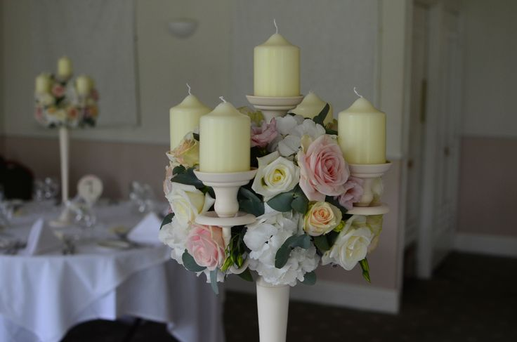 ivory candelabra with a ball of flowers