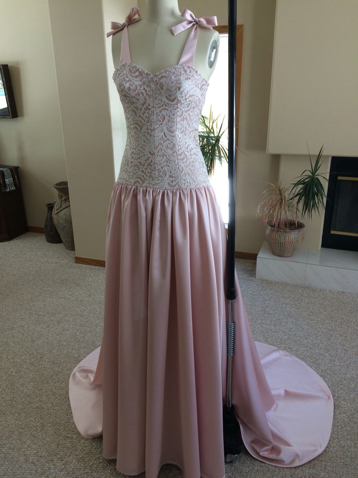 Spring bridal gown constructed with satin and lace and Swarovski crystals at the neckline