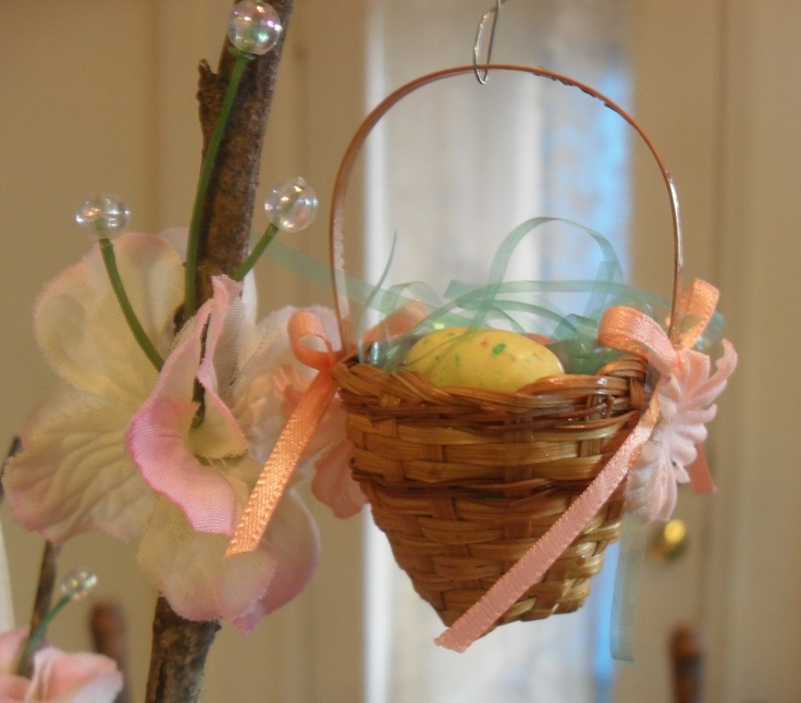 Easter Tree decorations: I glued bows and flowers to both sides of a small basket and added some grass and speckled malted milk ball Easter egg shaped candy. My grandson loves to inspect the tree and decorations to find the candy!
