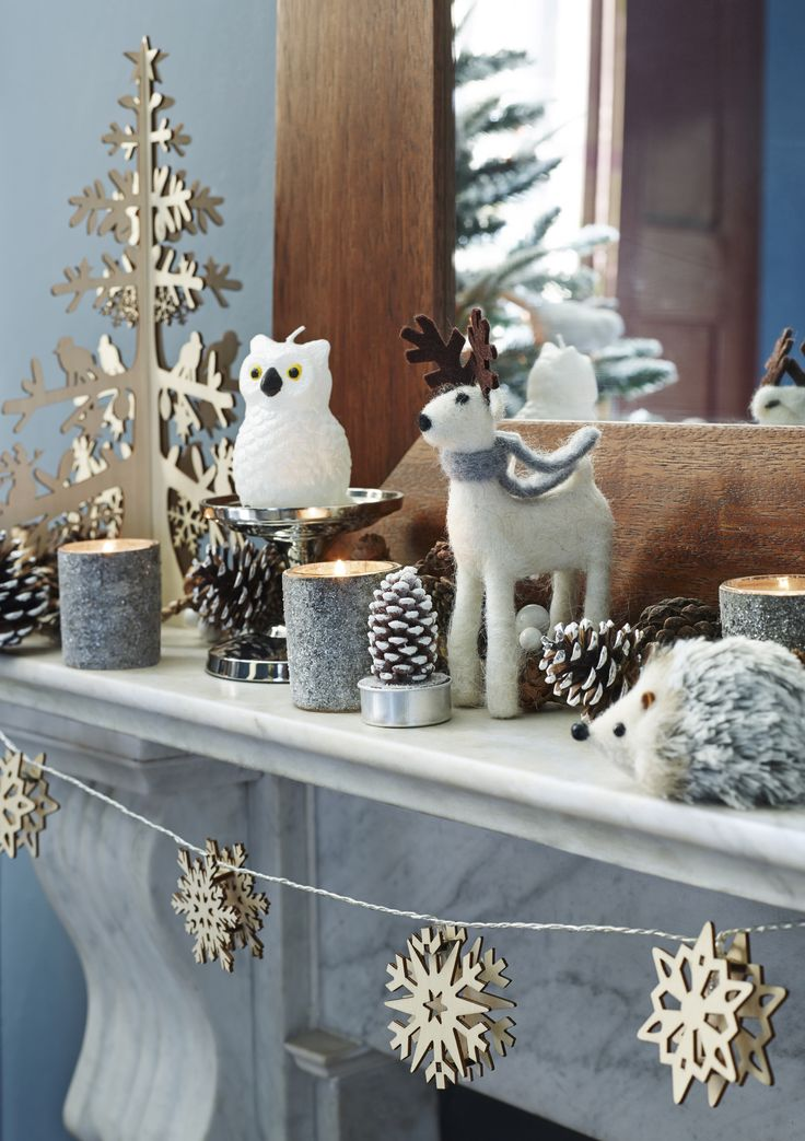 Instead of a Nativity scene, why not transform your mantlepiece into an enchanted forest? Embellish with fairy lights and add some fresh pine cones for fragrance!