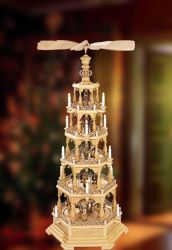 A beautiful German Erzgebirge Pyramid spreads warm light all over your living-room