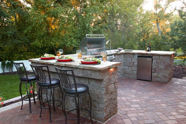 Awesome #outdoor #kitchen design with eating counter. Check more at www.newmexicohomes.com