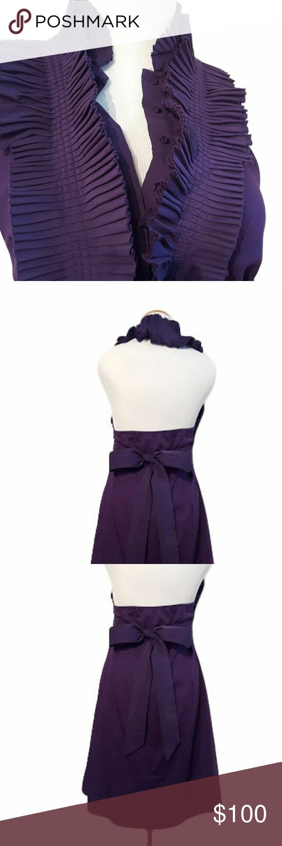 Royal Purple Queen Collared Dress The perfect purple dress for that special occasion when modesty meeting style is required; Or just the latter. Graduation, weddings, planned family events, dinners. Amazing pleated ruffle halter neckline, wraps entirely around neck down to bustline. Button up front. Huge bowtie back. Tighten front waistline to perfectly fit your curves & comfort. Falls just above knee. Purple everything, even the buttons and stitching! The most unique semi-casual occasion…