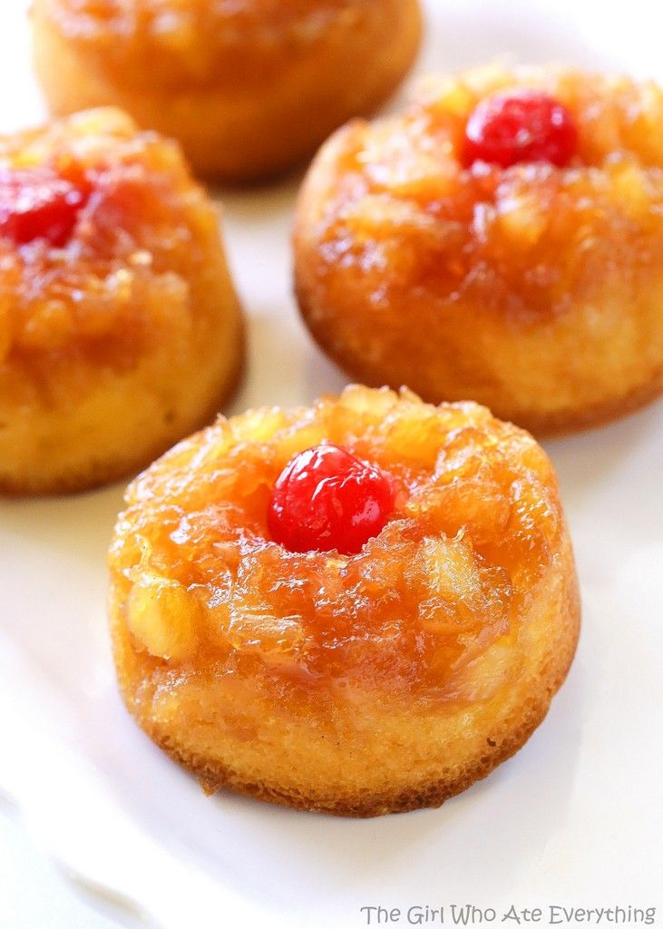 Pineapple Upside Down Cupcakes - a mini version of your favorite cake with butter, brown sugar, pineapple, and a cherry on top! Fun and cute dessert idea.