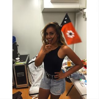 When she kept things simple in denim shorts while waving the Northern Territory flag. | 17 Times Jessica Mauboy Was A Style Queen On Instagram