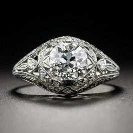 Few, if any, original Edwardian engagement rings come as fabulous as this rare and ravishing jewel, hand fabricated in platinum during the early part of the last century. Sparkling at the center is a 1.27 carat European-cut diamond. The light, lacy, mounting glitters with single-cut diamonds and is finished with neoclassic hand engraving. A superlative sparkler, currently ring size 5 3/4. (Hayden Wheeler was a jeweler based on Maiden Lane, New York,from about 1850 to the early-1930s.)