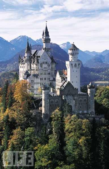 "Neuschwanstein Castle, Bavaria, Germany  Neuschwanstein Castle is the height of fairy tale castles. In fact, it was build for Ludwig II of Bavaria in 1869 by a theatrical set designer, rather than an architect. The name means ""New Swan Stone,"" after a Wagner opera.: Cinderella Castles, Castles View, Disney Castles, Neuschwanstein Castles, Tales Castles, Around The World, Castles In Germany, Bavaria Germany, Castles Germany"