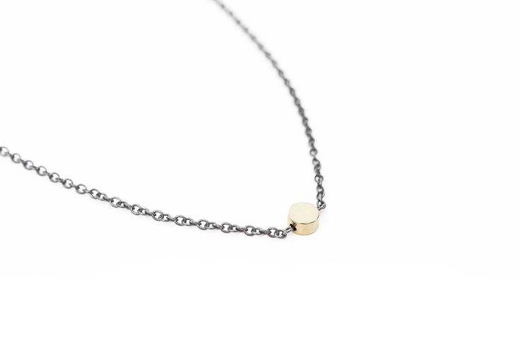 Oxidized silver necklace with shiny gold bead