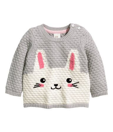Textured-knit sweater in a soft cotton blend with buttons at one shoulder and embroidery at front.