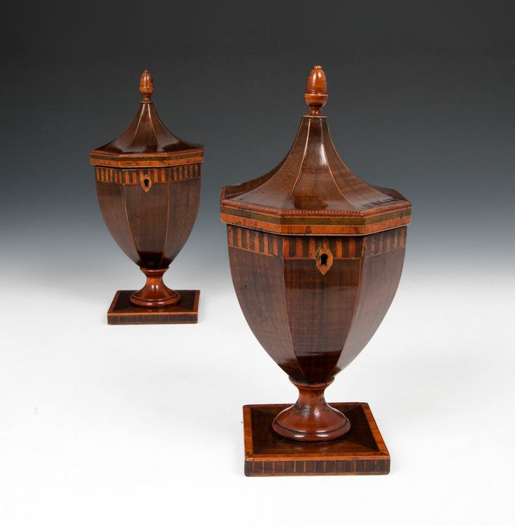 A rare pair of Georgian tea caddies in urn form, each with pagoda top and delightful acorn finial. Veneered in Harewood, with various inlaid bandings. www.hamptonantiques.co.uk