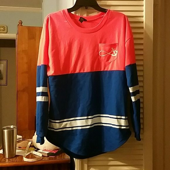 Infinity anchor jersey shirt NWOT Never worn. Coral, blue and white Jersey shirt. Pocket on front. 60% cotton and 40% polyester. 29 inches long. Rue 21 Tops Tees - Long Sleeve