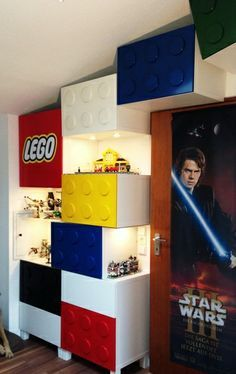 Ikea Hack: LEGO-themed storage with display areas.  Ikea Besta Shelves/Doors, with wooden coasters glued and spray painted to the doors... plus lighting... AWESOME!