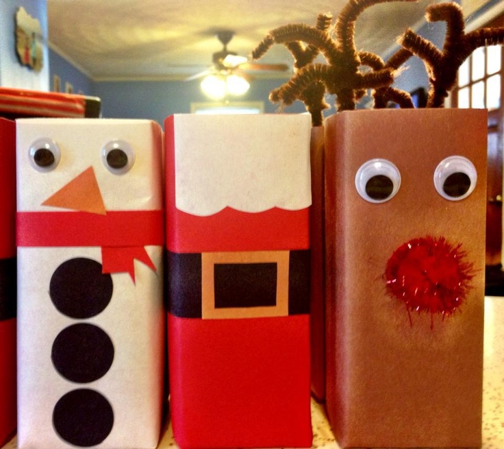 Christmas juice boxes. Scrapbook paper, tape, glue, wiggley eyes, poms, pipe cleaners and juice boxes.