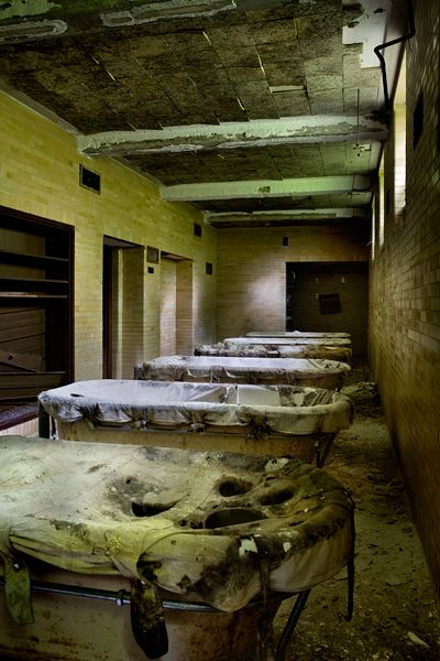 Tubs at asylum, used for continuous bath time treatment (unknown location)  http://www.opacity.us/ephemera/post/continuous_bath_time/