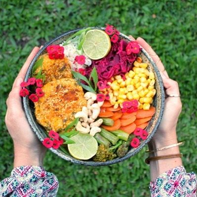Fresh, simple and colourful buddha bowl loaded with veggies, kraut and pumpkin and sesame vegan burger patties. Gluten Free, Dairy Free and Egg free.