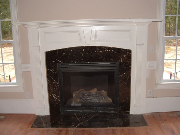 Classic Black Marble Fireplace Mantel Designs Ideas Inspiration Combined  With White Concrete Material In Minimalist Traditional Interior Room Decor
