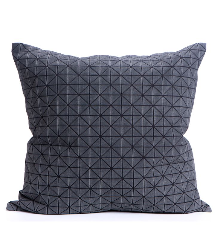 The Origami Cushion has a textured, geometric pattern that goes beyond standard two dimensionality into a unique, shape-making surface.