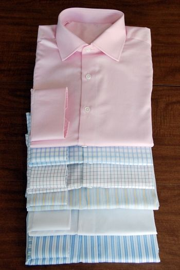 Stack of custom dress shirts of different colors and patterns #menstyle #dressshirt