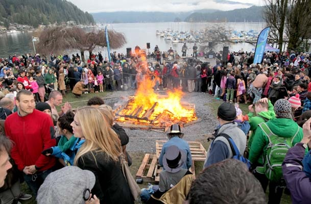 People gather around the bonfire to stay warm.