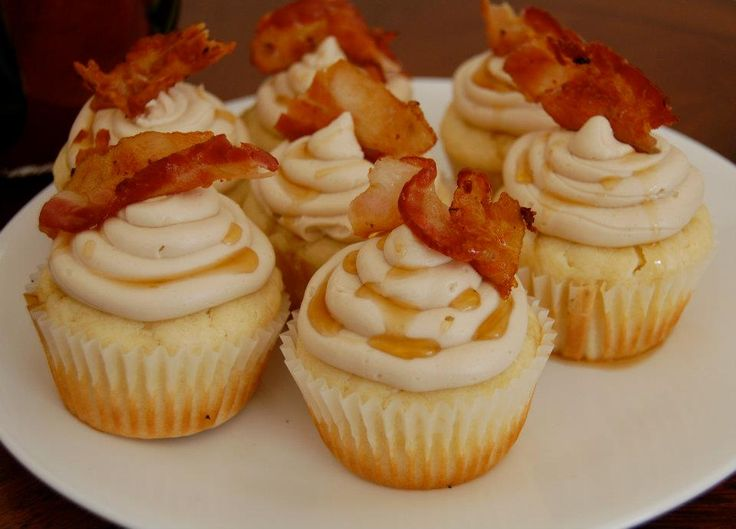 Pancake Breakfast Cupcake...A fluffy buttermilk pancake cupcake topped with a maple buttercream frosting and a garnished with piece of crispy bacon and maple syrup. Breakfast never tasted so good!