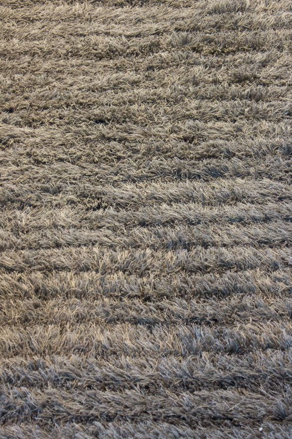 Woodnotes Aapa tufted carpet, col. warm grey. Aapa has a relief structure, and the varying pile height forms lively stripes and shadows.