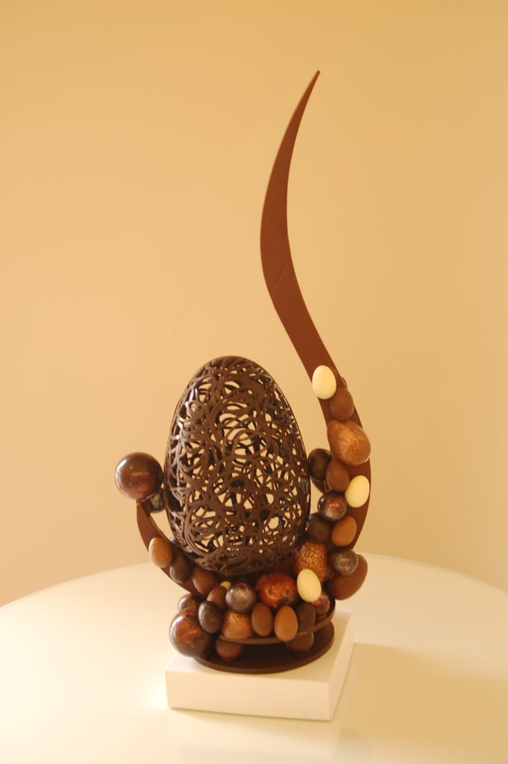 Chocolate lace egg and sculpture design a festive piece that can be devoured with family and friends : )