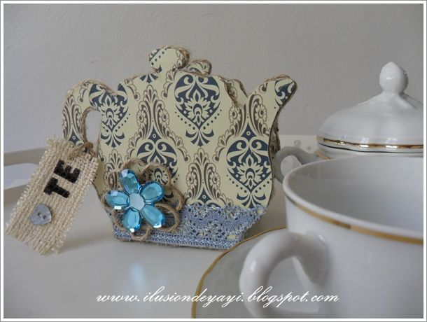 De Todo Un Poco: TUTORIAL: TEAPOT HOLDER FOR TEA BAGS (made from cardboard). More pictures on blog. Very cute.