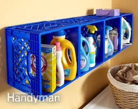 Screw inexpensive plastic crates to wall studs using a fender washer in the upper corner of each crate for extra strength. Crates hold a lot of supplies and keep tippy things from falling over.