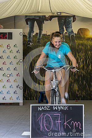 Young smiling women and man earn miles (kilometers) on tandem desktop.