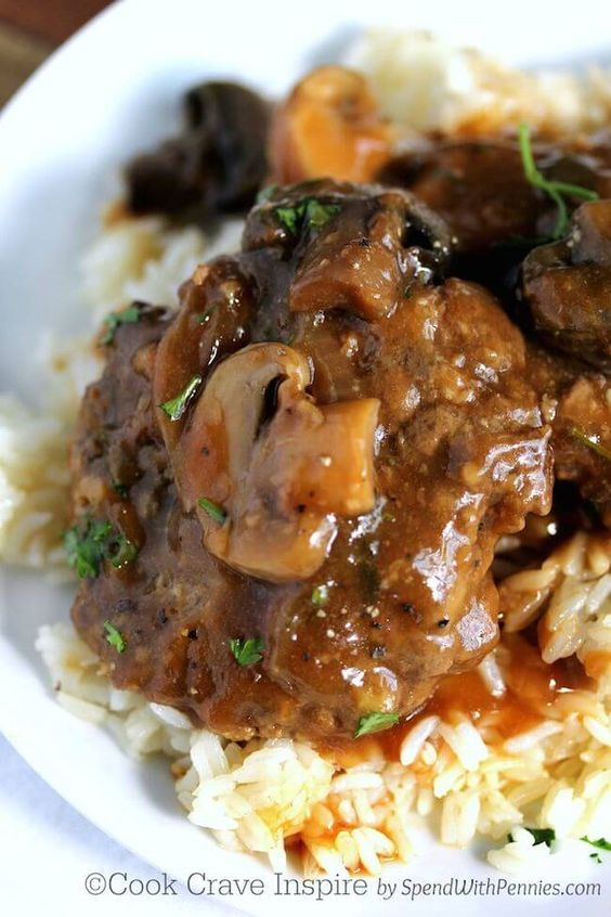 Slow Cooker Salisbury Steak! Perfectly tender beef patties simmered in the crock pot in a rich brown gravy with mushrooms! This is a family favorite!