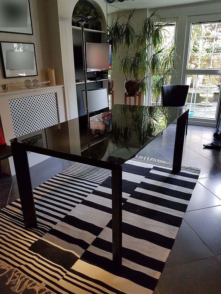 Link extendable black glass dining table. Modern and stylish table delivered to our client in London.