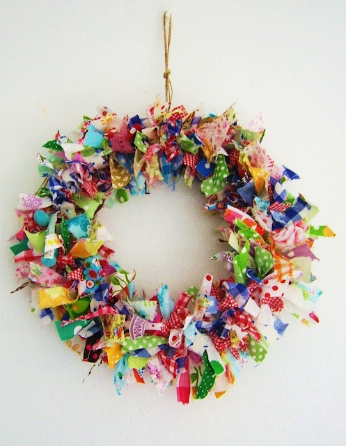Fabric wreath...cute on your door an good for inexpensive gifts for Christmas. Me an Lexie made them last year and she had so much fun. So simple to make, just cut strips of fabric then tie all around a wire hanger (bend hanger to form a circle).