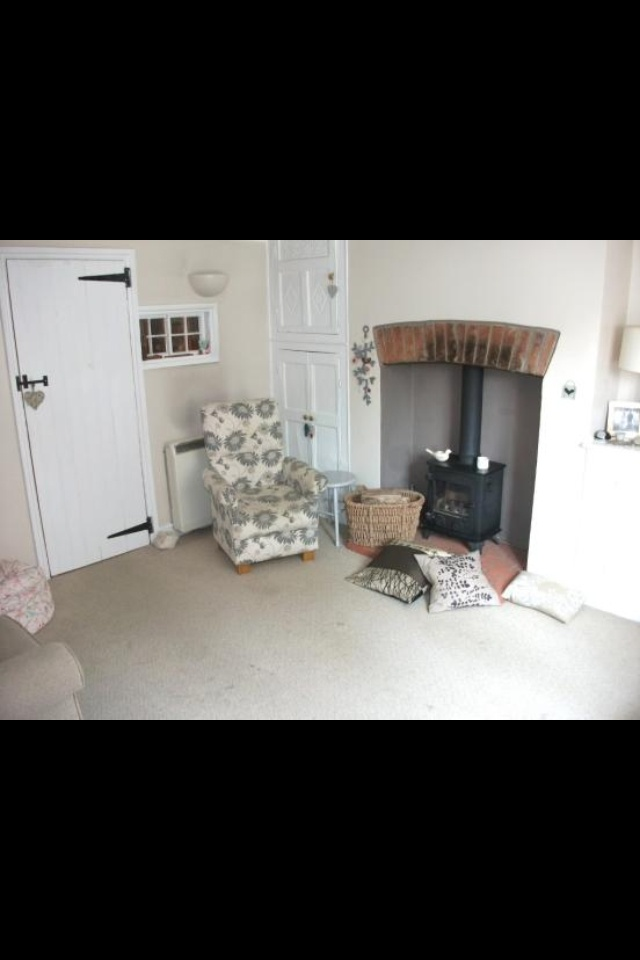 Log burner with bricks like ours at the top