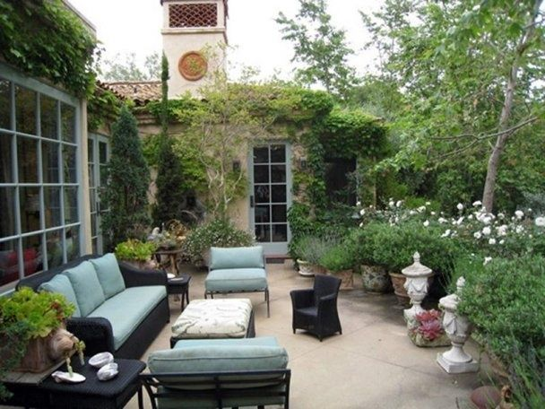 I love this patio!  So cozy!  We need to remove part of the lawn and plant adjacent to the patio.  Garden Design – French Farmhouse Style in Montecito, California