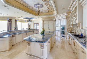 Mediterranean Kitchen with Inset cabinets, Stone Tile, Kitchen island, Complex granite counters, Undermount Sink, U-shaped