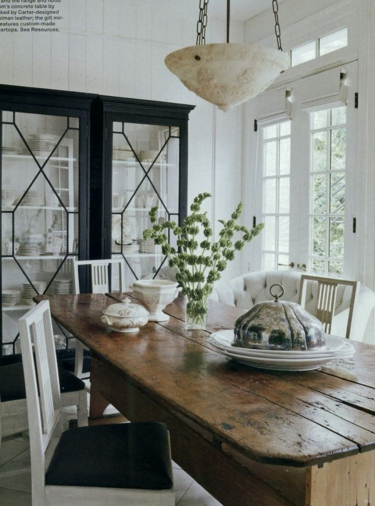 20 Great Shades of White Paint and Some To Avoid | wonderful eating area by Darryl Carter. That cabinet makes me swoon!