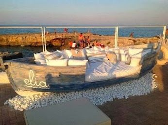 repurposed old vintage boat into seating sofa setting group for outdoor beach cottage garden need in my backyard