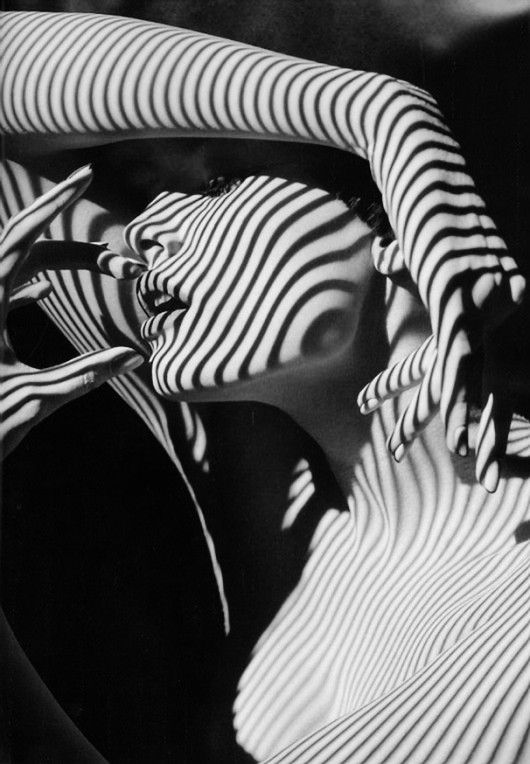 Blind shadow lines fall onto a woman's face and body.  Black and White.  Referenced by WHW1.com: WebSite Hosting - Affordable, Reliable, Fast, Easy, Advanced, and Complete.©
