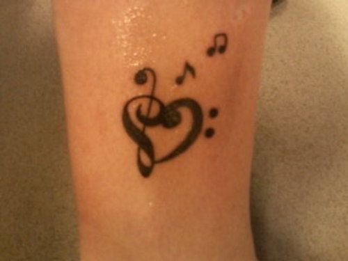 Treble clef, bass clef heart-shaped tattoo. I wanna get this on the base of my neck.
