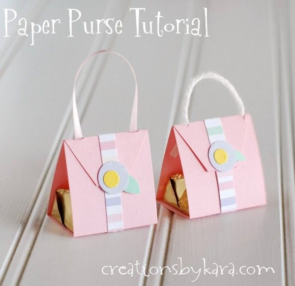 Paper purses with a Hershey nugget inside. A cute and easy paper craft. They make darling party favors! #papercraft #tutorial #purse creationsbykara.com