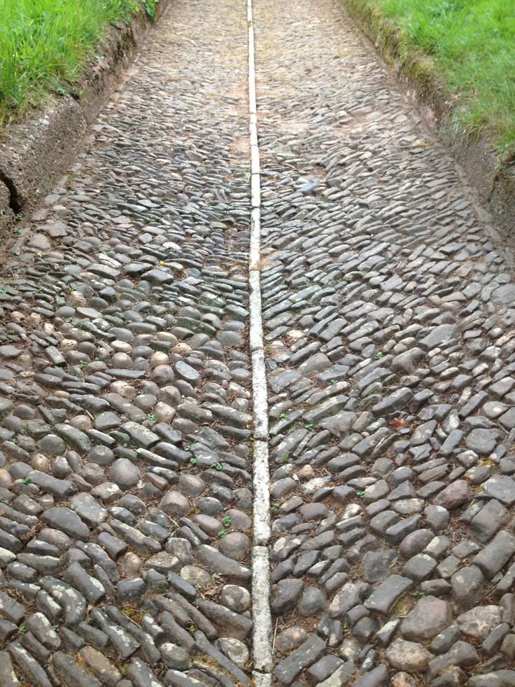 Cobbled Path | A cobbled pavement in as good a condition today as it was the day it was laid over a hundred years ago. By hand, and built to last out of local materials, it puts the blistered and fractured tarmac pavement of our more technologically advanced age to shame.