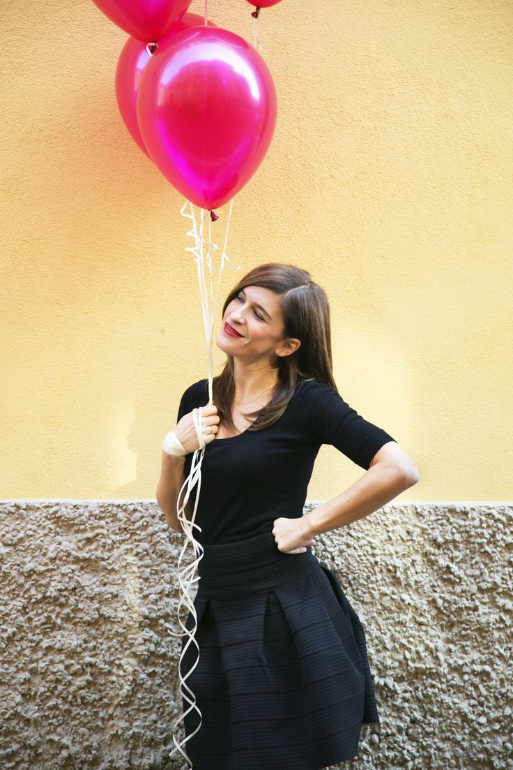 A girl with balloons in #Bologna