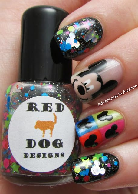"""Pop Art Mickey. It is described as """"mouse shaped silver holo glitters, mixed with neon pink and neon green stars, and various sized hex and  and square glitters in neon pink, neon green, neon blue and red, sprinkled with micro holo glitter in a clear base."""" Layered over plain black creme with top coat. Also the quad divided nail is done with neons as base to black Mickey heads."""